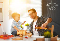 Father And Son Toddler Gather Craft A Car Out Of Wood And Play Royalty Free Stock Image