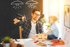 Father And Son Toddler Gather Craft A Car Out Of Wood And Play Royalty Free Stock Photo