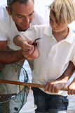 Father And Son With A Crab Royalty Free Stock Image