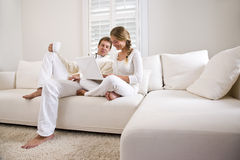 Free Father And Teen Daughter On White Sofa With Laptop Stock Photos - 11024743