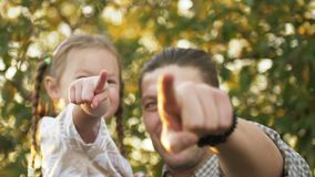 Father ang daughter spending time together, child girl pointing finger, smile pleasantly. Happy family enjoying stock video footage