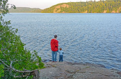 Father ans son enjoying the wilderness evening Royalty Free Stock Photo