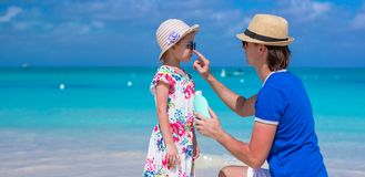 Father apply sunblock cream on his little daughter Royalty Free Stock Images