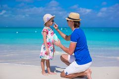 Father apply sunblock cream on his little daughter Stock Photo