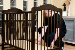 Father assembles new crib Stock Image