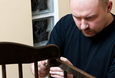 Father assembles new crib Stock Images