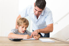 Father assisting son in homework Stock Photography
