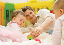 Father with babies royalty free stock photos