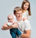 Father with babies Royalty Free Stock Photo