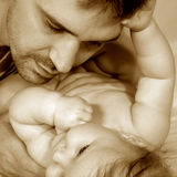 Father and baby. Portrait on a light  background Stock Photography