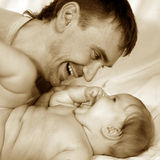 Father and baby. Portrait on a light background