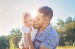 Father and baby in autumn outdoors Stock Photos