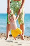 Father and baby on beach Stock Images