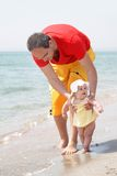 Father and baby on beach Royalty Free Stock Images