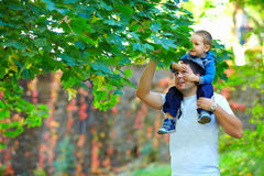 Father and baby boy enjoying colorful nature Stock Photo