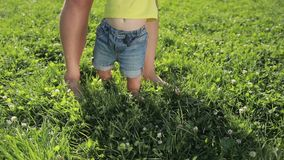 Father and baby boy feet walking barefoot on grass stock video footage