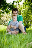 Father and baby boy outdoors Stock Photo