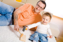 Father and baby boy playing Royalty Free Stock Photo
