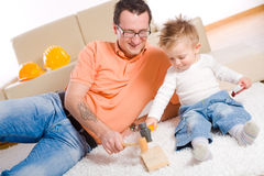 Father and baby boy playing Royalty Free Stock Photography