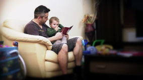 Father and Baby Boy Reading Stories,time lapse stock video footage