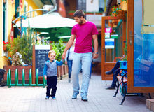 Father and baby boy walking the city street Stock Photo