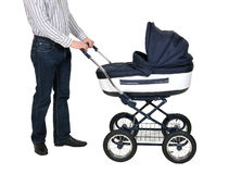 Father with baby carriage Stock Photography