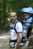 Father with baby in carrier. Father walking with 16 months old baby boy in backpack carrier. Family on walking tour Royalty Free Stock Images