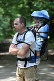 Father with baby in carrier. Father walking with 16 months old baby boy in backpack carrier. Family on walking tour Stock Image