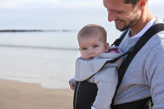 Father and Baby. Father carrying his baby on the beach Royalty Free Stock Image