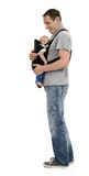 Father with baby. Father carrying his baby in carrier Royalty Free Stock Images