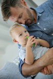Father and baby child having a snack Stock Image