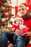 Father with baby in Christmas time stock image