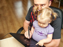 Father, baby and computer Royalty Free Stock Image