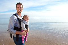 Father and Baby Daughter on Beach Stock Image
