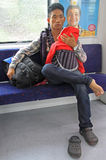 Father with baby daughter in carrage of commuter Stock Photography