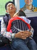 Father with baby daughter in carrage of commuter Stock Photo