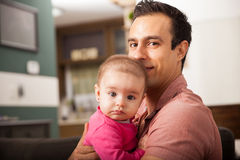 Father and baby daughter relaxing at home Royalty Free Stock Photography