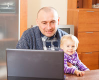 Father and baby daughter at work Royalty Free Stock Photo