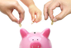Father and a baby do saving money Royalty Free Stock Photo