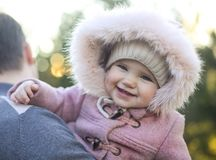 Father with baby embracing in the autumn park. Happy portrait stock photography