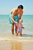 Father and baby girl on the beach Stock Photo