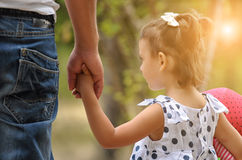 Father and baby girl holding hand in hand Stock Images
