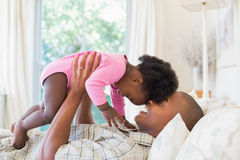 Father and baby girl lying on bed together Royalty Free Stock Photo