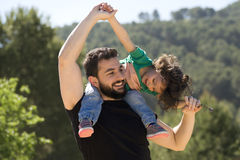 Father and baby girl playing outdoors Royalty Free Stock Photography