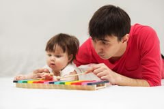 Father and baby girl playing xylophone toy at home Royalty Free Stock Image