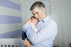 Father and baby at home together, bedtime Stock Photos