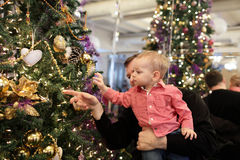 Father with baby near Christmas tree Royalty Free Stock Photos