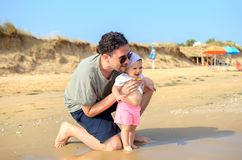 Father and baby newborn at the sea shore beach in summer family Royalty Free Stock Photography