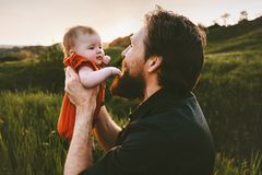 Father with baby outdoor happy family lifestyle. Fathers day holiday dad and infant child walking together summer vacations parenthood childhood concept stock photography