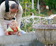 Father and baby in park Stock Images